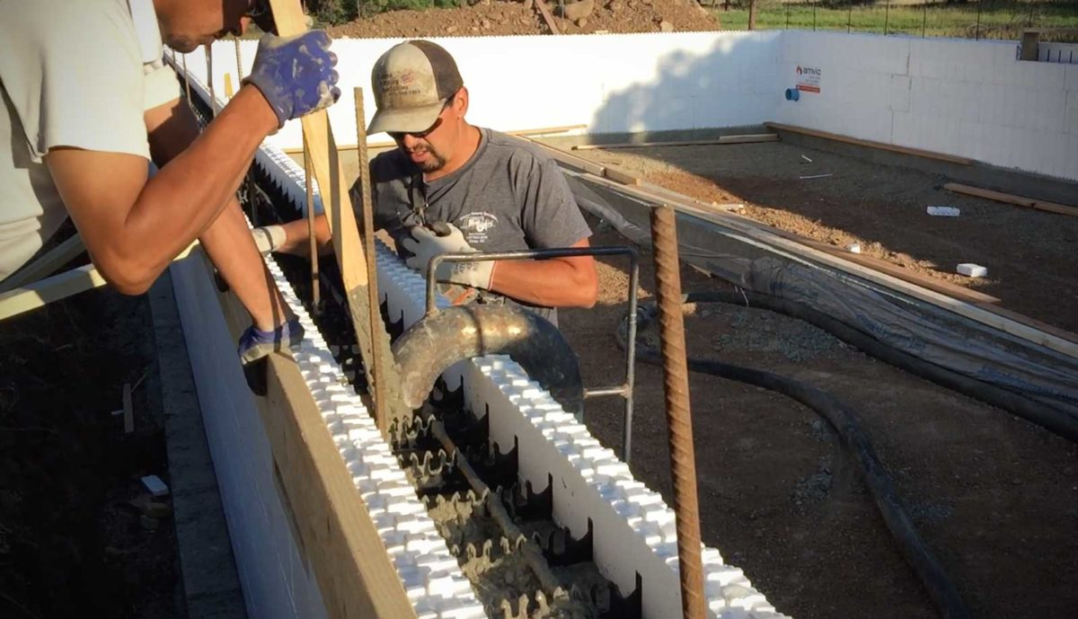 Insulated concrete form being poured icf